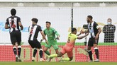 Manchester City's Gabriel Jesus, second right, is fouled by Newcastle's Fabian Schaer to get a penalty during the FA Cup sixth round soccer match between Newcastle United and Manchester City at St. James' Park in Newcastle, England, Sunday, June 28, 2020. (Owen Humphreys/Pool via AP)