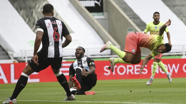 Manchester City's Gabriel Jesus is sent flying in a challenge by Newcastle's Danny Rose during the FA Cup sixth round soccer match between Newcastle United and Manchester City at St. James' Park in Newcastle, England, Sunday, June 28, 2020. (Owen Humphreys/Pool via AP)