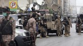 Security personnel surround the Stock Exchange Building after gunmen's attack in Karachi, Pakistan, Monday, June 29, 2020. Special police forces deployed to the scene of the attack and in a swift operation secured the building. (AP Photo/Fareed Khan)