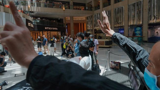 Protesters gather at a shopping mall in Central during a pro-democracy protest against Beijing's national security law in Hong Kong, Tuesday, June 30, 2020. Hong Kong media are reporting that China has approved a contentious law that would allow authorities to crack down on subversive and secessionist activity in Hong Kong, sparking fears that it would be used to curb opposition voices in the semi-autonomous territory. (AP Photo/Vincent Yu)