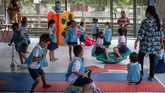 Children play at Makkasan preschool in Bangkok, Thailand, Wednesday, July 1, 2020. Thailand has begun a fifth phase of relaxations of COVID-19 restrictions, allowing the reopening of schools and high-risk entertainment venues such as pubs and massage parlors that had been shut since mid-March. (AP Photo/ Gemunu Amarasinghe)