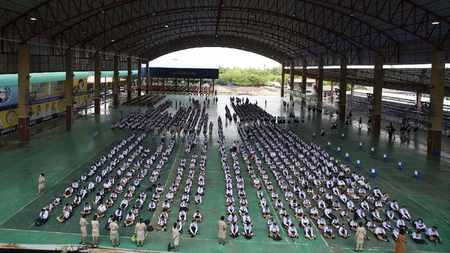 Students attend a general assembly the Samkhok School in Pathum Thani, outside Bangkok, Wednesday, July 1, 2020. Thailand has begun a fifth phase of relaxations of COVID-19 restrictions, allowing the reopening of schools and high-risk entertainment venues such as pubs and massage parlors that had been shut since mid-March. (AP Photo/Sakchai Lalit)