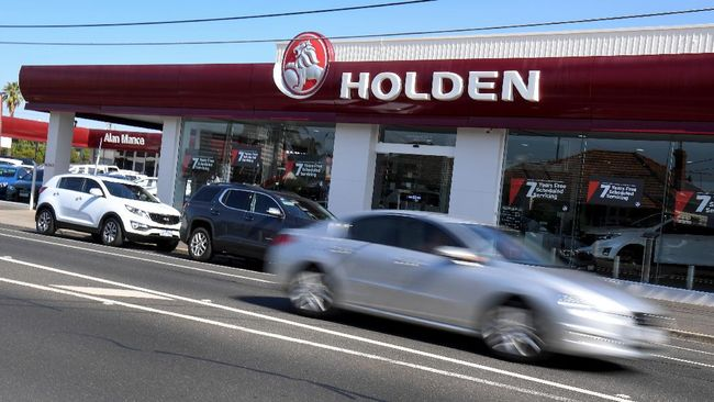 A car drives past a Holden dealership in Melbourne on February 17, 2020. - General Motors announced on February 17 it would scrap struggling Australian car brand Holden, with engineering, design and sales operations to be wound down in the coming months. (Photo by William WEST / AFP)