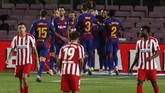 FC Barcelona, background, celebrate their side's second goal during the Spanish La Liga soccer match between FC Barcelona and Atletico Madrid at the Camp Nou stadium in Barcelona, Spain, Tuesday, June 30, 2020. (AP Photo/Joan Monfort)