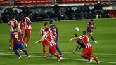 Barcelona's Lionel Messi kicks the ball during the Spanish La Liga soccer match between FC Barcelona and Atletico Madrid at the Camp Nou stadium in Barcelona, Spain, Tuesday, June 30, 2020. (AP Photo/Joan Monfort)