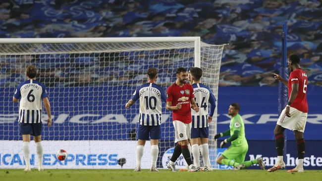Manchester United's Bruno Fernandes reacts after scoring his side's second goal during the English Premier League soccer match between Brighton & Hove Albion and Manchester United at the AMEX Stadium in Brighton, England, Tuesday, June 30, 2020. (AP Photo/Alastair Grant, Pool)