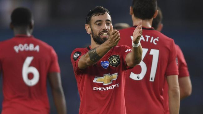 Manchester United's Bruno Fernandes reacts after scoring his side's second goal during the English Premier League soccer match between Brighton & Hove Albion and Manchester United at the AMEX Stadium in Brighton, England, Tuesday, June 30, 2020. (Mike Hewitt/Pool via AP)