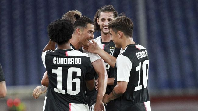 Juventus' Cristiano Ronaldo, center, celebrates after scoring a goal during an Italian Serie A soccer match between Genoa and Juventus at the Luigi Ferraris stadium in Genoa, Italy, Tuesday, June 30, 2020. (Tano Pecoraro/LaPresse via AP)