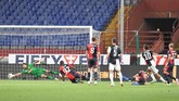 Juventus' Paulo Dybala, second right, scores a goal during an Italian Serie A soccer match between Genoa and Juventus at the Luigi Ferraris stadium in Genoa, Italy, Tuesday, June 30, 2020. (Tano Pecoraro/LaPresse via AP)