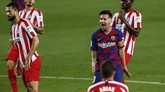 Barcelona's Lionel Messi reacts after missing a shoot during the Spanish La Liga soccer match between FC Barcelona and Atletico Madrid at the Camp Nou stadium in Barcelona, Spain, Tuesday, June 30, 2020. (AP Photo/Joan Monfort)
