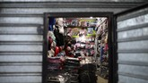 A seller looks out from her shop amid the new coronavirus pandemic, in Buenos Aires, Argentina, Friday, June 26, 2020. Argentine President Alberto Fernandez is expected to announce a rollback on restrictions to the lockdowns to stop the spread of COVID-19, in place since March 20th. (AP Photo/Natacha Pisarenko)