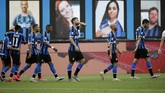 Inter Milan's Roberto Gagliardini, third from right, celebrates after scoring his side's fourth goal during the Serie A soccer match between Inter Milan and Brescia at the San Siro Stadium, in Milan, Italy, Wednesday, July 1, 2020. (AP Photo/Luca Bruno)
