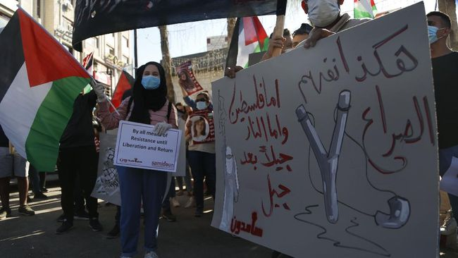Palestinians demonstrate against Israeli plans for the annexation of parts of the West Bank, in the in the West Bank city of Ramallah, Wednesday, July 1, 2020.The Arabic reads :