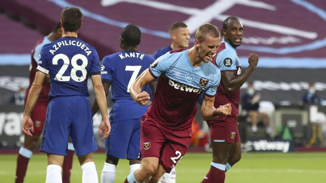 West Ham's Tomas Soucek, celebrates after scoring his sides first goal during the English Premier League soccer match between West Ham United and Chelsea at the London Stadium in London, Wednesday, July, 1, 2020. (Julian Finney/Pool via AP)
