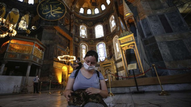 People visit the Byzantine-era Hagia Sophia, one of Istanbul's main tourist attractions in the historic Sultanahmet district of Istanbul, Thursday, June 25, 2020. Turkey's highest administrative court on Thursday July 2, 2020, began considering a request for the UNESCO World Heritage site that now serves as a museum be reverted back into a mosque. (AP Photo/Emrah Gurel)