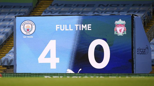 Scoreboard shows final score in the English Premier League soccer match between Manchester City and Liverpool at Etihad Stadium in Manchester, England, Thursday, July 2, 2020. (AP Photo/Laurence Griffiths,Pool)