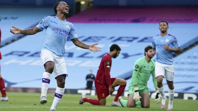 Manchester City's Raheem Sterling celebrates after scoring his team's second goal during the English Premier League soccer match between Manchester City and Liverpool at Etihad Stadium in Manchester, England, Thursday, July 2, 2020. (AP Photo/Dave Thompson,Pool)