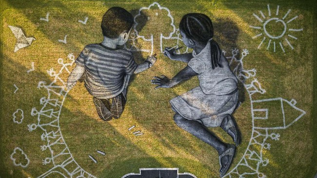 In this picture made available Friday, June 26, 2020 an aerial view shows a giant ephemeral landart painting by Swiss French artist Saype entitled