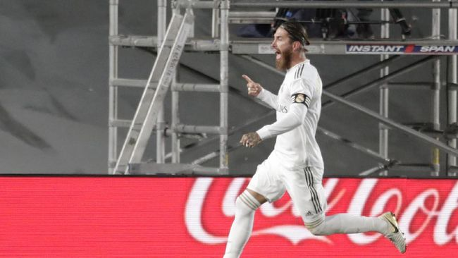 Real Madrid's Sergio Ramos celebrates after scoring his side's opening goal from a penalty shot during the Spanish La Liga soccer match between Real Madrid and Getafe at the Alfredo di Stefano stadium in Madrid, Spain, Thursday, July 2, 2020. (AP Photo/Bernat Armangue)