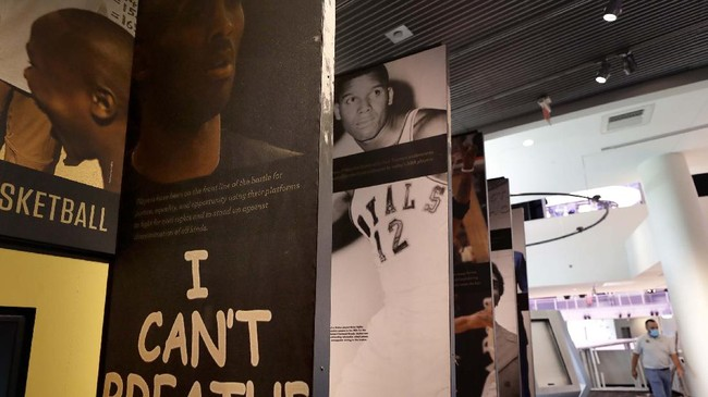 An exhibit at the Naismith Memorial Basketball Hall of Fame, in Springfield, Mass., shown Tuesday, June 23, 2020, pays tribute to athletes and those who have fought for racial equality and justice. The museum is scheduled to reopen in the beginning of July 2020 with a whole new look after a $22 million renovation.  (AP Photo/Steven Senne)