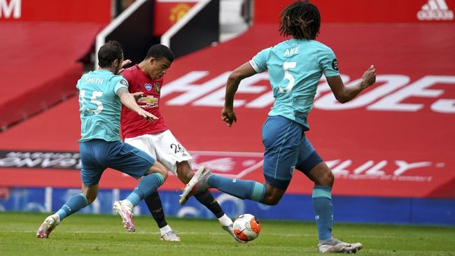 Manchester United's Mason Greenwood shoots before scoring a goal during the English Premier League soccer match between Manchester United and Bournemouth at Old Trafford stadium in Manchester, England, Saturday, July 4, 2020. (Dave Thompson/Pool via AP)