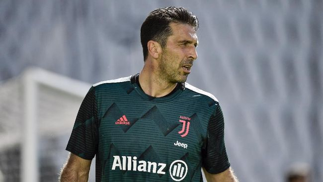 Juventus goalie Gianluigi Buffon warms-up prior to the Serie A soccer match between Juventus and Torino, at the Allianz Stadium in Turin, Italy, Saturday, July 4, 2020. Juventus goalkeeper Gianluigi Buffon set an outright Serie A record on Saturday with his 648th appearance in Italy's top flight. The Turin derby game against Torino moved the 42-year-old Buffon one ahead of AC Milan great Paolo Maldini, who set the record in 2009. (Marco Alpozzi/LaPresse via AP)