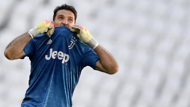 Juventus goalie Gianluigi Buffon reacts during the Serie A soccer match between Juventus and Torino, at the Allianz Stadium in Turin, Italy, Saturday, July 4, 2020. Juventus goalkeeper Gianluigi Buffon set an outright Serie A record on Saturday with his 648th appearance in Italy's top flight. The Turin derby game against Torino moved the 42-year-old Buffon one ahead of AC Milan great Paolo Maldini, who set the record in 2009. (Fabio Ferrari/LaPresse via AP)