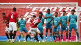 Manchester United's Bruno Fernandes (18) shoots a goal-scoring free kick during the English Premier League soccer match between Manchester United and Bournemouth at Old Trafford stadium in Manchester, England, Saturday, July 4, 2020. (Clive Brunskill/Pool via AP)