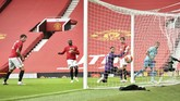 Bournemouth's Junior Stanislas, right, watches the net after scoring a goal during the English Premier League soccer match between Manchester United and Bournemouth at Old Trafford stadium in Manchester, England, Saturday, July 4, 2020. (Peter Powell/Pool via AP)
