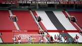 Empty stands are seen as Manchester United's Paul Pogba (6) shoots a free kick during the English Premier League soccer match between Manchester United and Bournemouth at Old Trafford stadium in Manchester, England, Saturday, July 4, 2020. (Dave Thompson/Pool via AP)