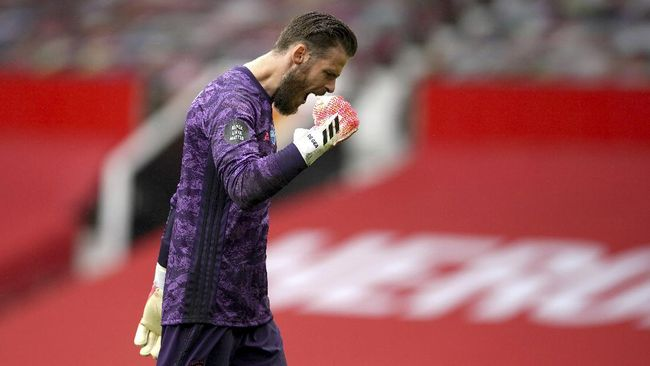 Manchester United's goalkeeper David de Gea reacts after a goal by teammate Mason Greenwood during the English Premier League soccer match between Manchester United and Bournemouth at Old Trafford stadium in Manchester, England, Saturday, July 4, 2020. (Dave Thompson/Pool via AP)