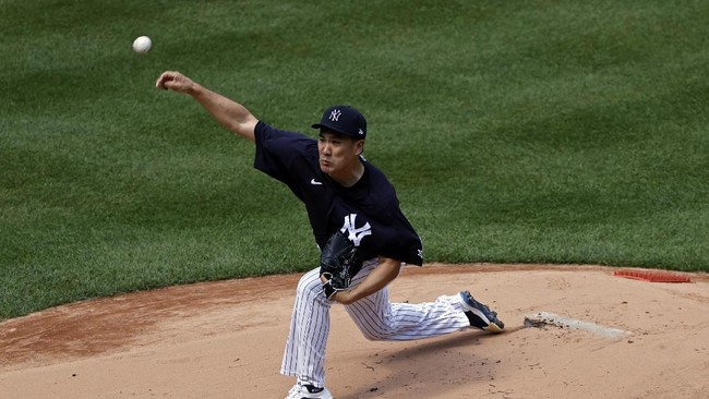 New York Yankees pitcher Masahiro Tanaka delivers a pitch during a baseball a workout at Yankee Stadium in New York, Saturday, July 4, 2020. (AP Photo/Adam Hunger)