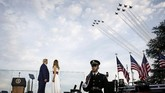 President Donald Trump and first lady Melania Trump watch as the U.S. Air Force Thunderbirds and U.S. Navy Blue Angels perform a flyover during a