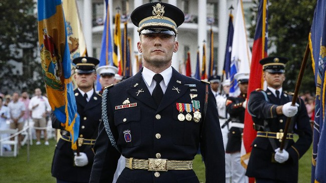 Service members stand on the South Lawn of the White House during a