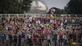 Crowds watch flyovers from the National Mall during a