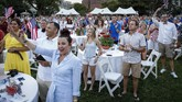 People gather on the South Lawn of the White House during a