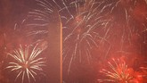 Fireworks explode around the Washington Monument during a