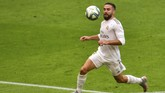 Real Madrid's Dani Carvajal views the ball during the Spanish La Liga soccer match between Athletic Club and Real Madrid at the San Manes stadium in Bilbao, Spain, Sunday, July 5, 2020. (AP Photo/Alvaro Barrientos)