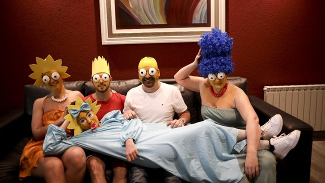 The Arevalo-Robledo family, dressed as The Simpsons, poses for a photo in their living room during a government-ordered lockdown to curb the spread of the new coronavirus in Buenos Aires, Argentina, Saturday, June 27, 2020. Mariano Arevalo is Homer, Mariel Robledo is Marge, Federico Garozzo is Bart, Julieta is Lisa and Camila Arevalo is Maggie. This family said every day of lockdown started to look the same, so they decided every Saturday to dress in different costumes to combat boredom and put some humor into their lives. (AP Photo/Natacha Pisarenko)