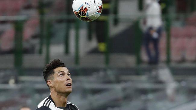 Juventus' Cristiano Ronaldo controls the ball during the Serie A soccer match between AC Milan and Juventus at the San Siro stadium, in Milan, Italy, Tuesday, July 7, 2020. (AP Photo/Antonio Calanni)