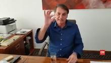 VIDEO: Kena Covid, Bolsonaro Pamer Minum Hydroxychloroquine