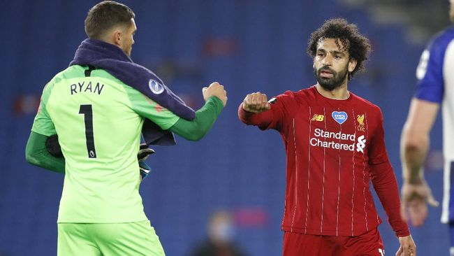 Liverpool's Mohamed Salah, right, gestures with Brighton's goalkeeper Mathew Ryan after the English Premier League soccer match between Brighton and Liverpool at Falmer Stadium in Brighton, England, Wednesday, July 8, 2020. (AP Photo/Paul Childs,Pool)
