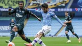 Manchester City's David Silva shots past Newcastle's Valentino Lazaro, left, during the English Premier League soccer match between Manchester City and Newcastle at the Ethiad Stadium in Manchester, England, Wednesday, July 8, 2020. (Lee Smith/Pool via AP)