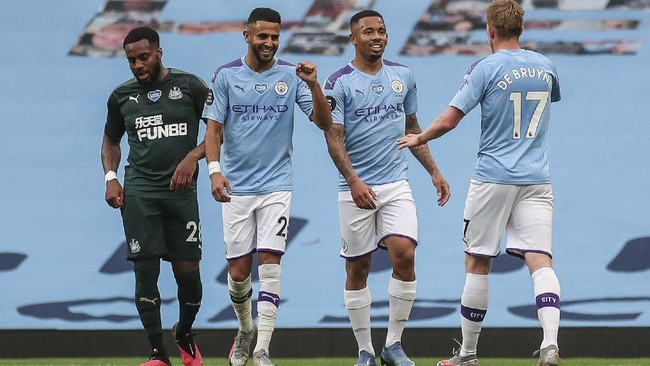 Manchester City players celebrate a goal during the English Premier League soccer match between Manchester City and Newcastle at the Ethiad Stadium in Manchester, England, Wednesday, July 8, 2020. (Lee Smith/Pool via AP)