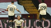 Manchester United's Mason Greenwood celebrates with teammate's Bruno Fernandes, left, and Aaron Wan-Bissaka, right, after scoring his team's second goal during the English Premier League soccer match between Aston Villa and Manchester United at Villa Park in Birmingham, England, Thursday, July 9, 2020. (AP PhotoAndrew Boyers,Pool)
