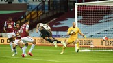 Manchester United's Aaron Wan-Bissaka attempts to head the ball into the net during the English Premier League soccer match between Aston Villa and Manchester United at Villa Park in Birmingham, England, Thursday, July 9, 2020. (AP PhotoAndrew Boyers,Pool)