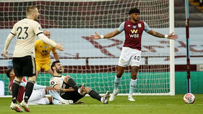 Manchester United's Bruno Fernandes reacts as he is fouled in the penalty box during the English Premier League soccer match between Aston Villa and Manchester United at Villa Park in Birmingham, England, Thursday, July 9, 2020. (AP PhotoAndrew Boyers,Pool)
