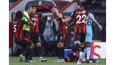 Bournemouth players argue with the referee during the English Premier League soccer match between Bournemouth and Tottenham at the Vitality Stadium in Bournemouth, England, Thursday, July 9, 2020. (Richard Heathcote/Pool via AP)