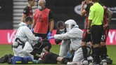 Bournemouth's Adam Smith receives medical attention during the English Premier League soccer match between Bournemouth and Tottenham at the Vitality Stadium in Bournemouth, England, Thursday, July 9, 2020.(Neill Hall/Pool via AP)