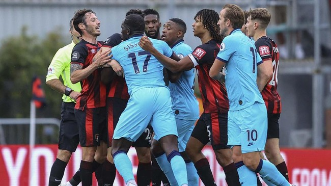 Bournemouth and Tottenham players scuffle during the English Premier League soccer match at the Vitality Stadium in Bournemouth, England, Thursday, July 9, 2020. (Richard Heathcote/Pool via AP)